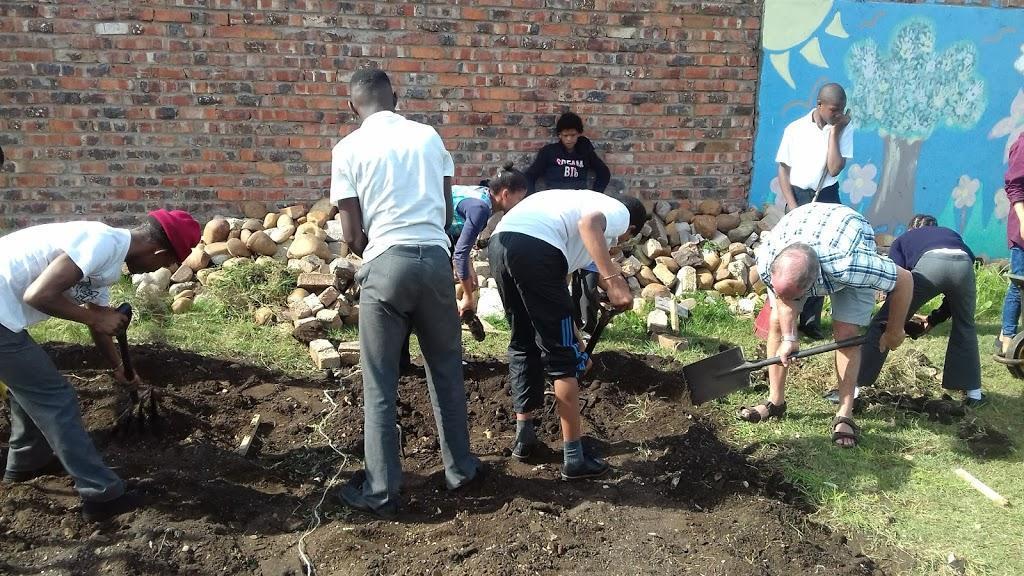 Kids Having A Jol In The Joshua Project Garden