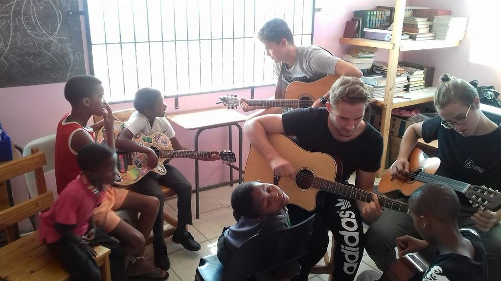 Teaching Joshua Project Kids To Play Guitar